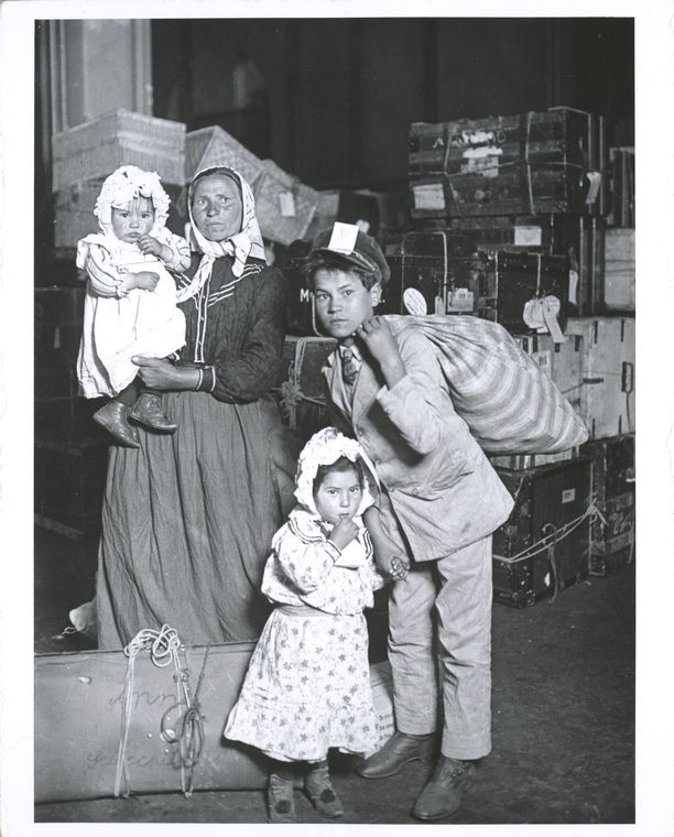 Immigrant family looking for lost baggage, Ellis Island