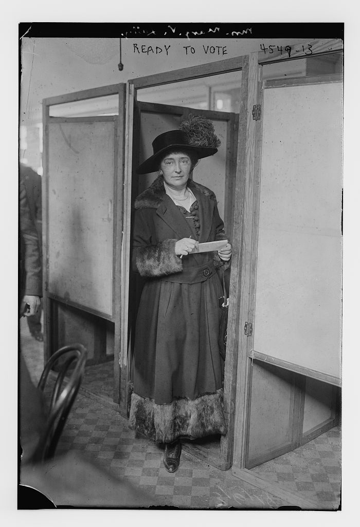 Photograph of a woman waiting to vote