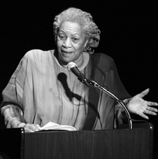 Toni Morrison delivering a speech at a podium in 2008